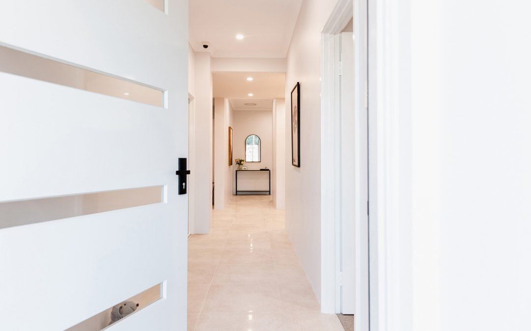 Looking into a Perth home built by smart homes for living, down a well-lit stylish hallway